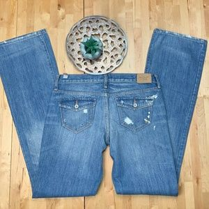 Boot cut distressed jeans light wash